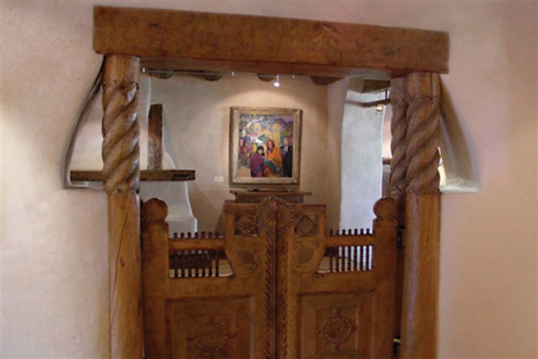 Carved swining door made by Nicolai Fechin