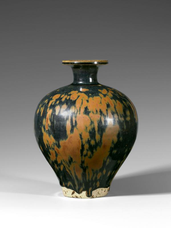 A rust-splashed black-glazed ovoid bottle-vase, Song Dynasty (960–1279)