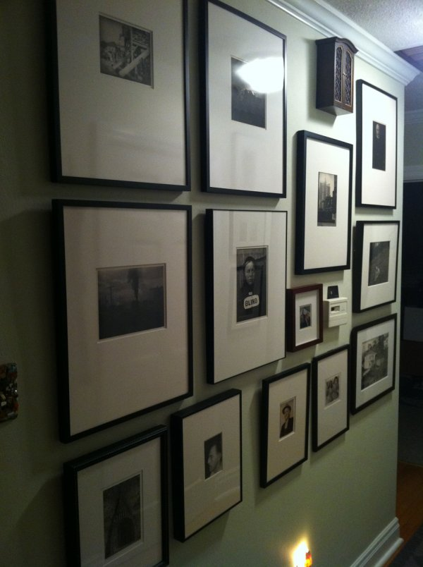 Framed photographs on a wall in the St. Louis home of the collecting couple, John and Teenuh Foster.