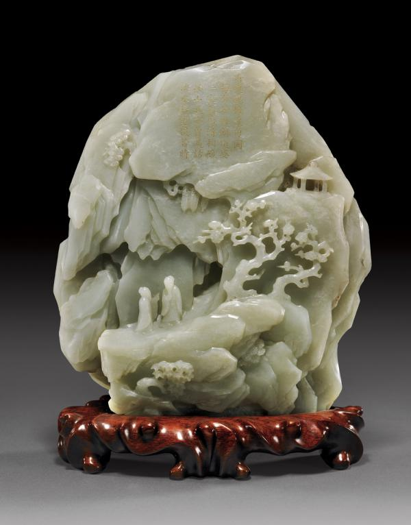 a Qianlong-era (1736–95) jade mountain carving, with a detail of the Chinese inscription on it.
