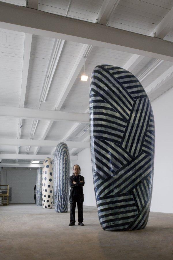 Jun Kaneko next to his Untitled, Dango, 2013, hand built glazed ceramics, 108.5 x 47 x 27 inches.