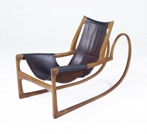 Wendell Castle, oak sleigh chair with hard leather sling seat, 1963