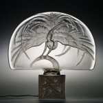 René Lalique, Illuminated Surtout de table, Oiseau de Feu (Firebird), R. Lalique et Cie., circa 1922, mold-pressed, acid-etched intaglio design, 42.2 cm.