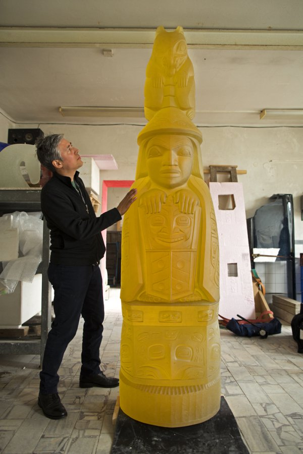 Preston Singletary in the studio with his totem pole;