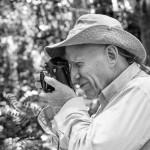 Sebastião Salgado photographing.