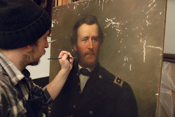 Restorer Matt Bergbauer inpainting a portrait of General Ulysses S. Grant