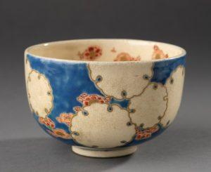 Tea bowl with floral design on blue background