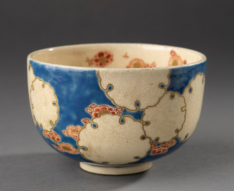 Tea bowl with floral design on blue background